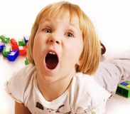 Little cute blond girl emotional screaming in. Camera on white background isolated Stock Photography