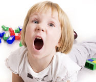 Little cute blond girl emotional screaming in Royalty Free Stock Photography