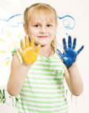 Little cute blond girl painting isolated on white Royalty Free Stock Photo