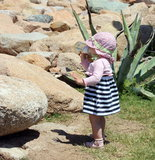 Little cute blond girl  at the port in Porto Cervo. Sardinia Royalty Free Stock Photos