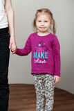 Little cute blonde girl is holding mother's hand Stock Image