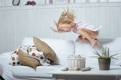 Little cute blonde norwegian real girl playing at Stock Images