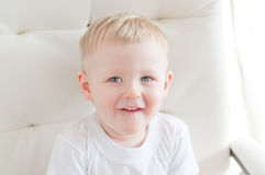 Little smiling boy is looking up. Little cute blue-eyed  boy is looking up and smiling Stock Image
