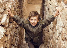 Little cute boy among ancient ruins Royalty Free Stock Photography