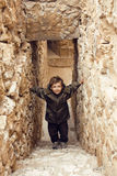Little cute boy among ancient ruins Royalty Free Stock Images
