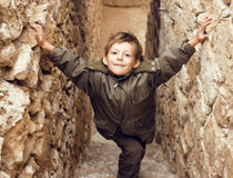 Little cute boy among ancient ruins Royalty Free Stock Photos