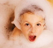 Little cute boy in bathroom. With bubbles stock photos