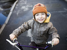 Little cute boy on bicycle smiling Royalty Free Stock Photos