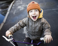 Little cute boy on bicycle smiling Royalty Free Stock Image