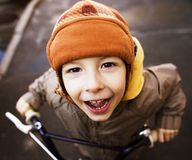 Little cute boy on bicycle smiling close up Royalty Free Stock Images