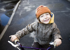 Little cute boy on bicycle smiling close up outside Stock Images