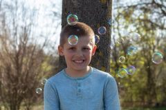 Little cute boy blowing bubbles in the Park stock photography
