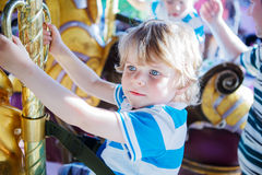 Little cute boy during carousel ride, enjoying and having fun Stock Photography