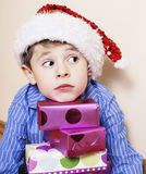 Little cute boy with Christmas gifts at home Royalty Free Stock Photos