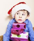 Little cute boy with Christmas gifts at home. close up emotional Royalty Free Stock Photo