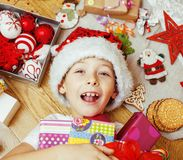 Little cute boy with Christmas gifts at home. close up emotional happy smiling in mess with toys, lifestyle holiday Royalty Free Stock Images