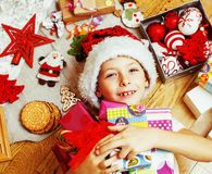 Little cute boy with Christmas gifts at home. close up emotional Stock Image