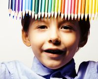 Little cute boy with color pencils close up smiling, education f Royalty Free Stock Image