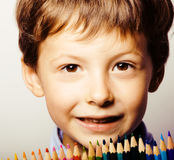 Little cute boy with color pencils close up smiling, education f royalty free stock photography