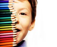 Little cute boy with color pencils close up smiling, education f royalty free stock images