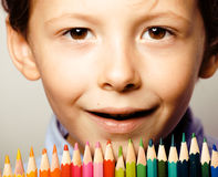 Little cute boy with color pencils close up Stock Photography