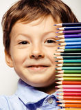 Little cute boy with color pencils close up smiling Stock Photography