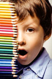 Little cute boy with color pencils close up smiling Stock Photos