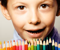 Little cute boy with color pencils close up smiling Royalty Free Stock Photos