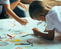 Little cute boy with company painting on birthday Stock Photo