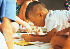 Little cute boy with company painting on birthday party Royalty Free Stock Images
