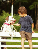 Little cute boy with dalmatian dog Royalty Free Stock Photography