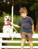 Little cute boy with dalmatian dog Stock Images