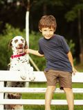 Little cute boy with dalmatian dog Royalty Free Stock Image