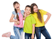Little cute boy embracing two laughing little girls Royalty Free Stock Image