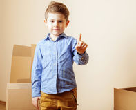 Little cute boy in empty room, remoove to new Royalty Free Stock Photos
