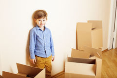 Little cute boy in empty room, remoove to new Stock Photo