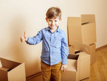 Little cute boy in empty room, remoove to new Royalty Free Stock Photography