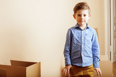 Little cute boy in empty room, remoove to new Stock Photography