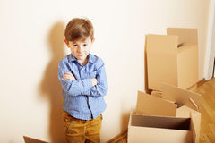 Little cute boy in empty room, remoove to new Royalty Free Stock Images