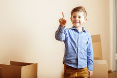 Little cute boy in empty room, remoove to new Stock Image