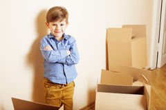 Little cute boy in empty room, remoove to new house. home alone emong boxes Stock Photography