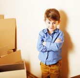 Little cute boy in empty room, remoove to new house. home alone, Royalty Free Stock Photography