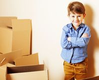 Little cute boy in empty room, remoove to new house. home alone, Stock Image