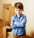 Little cute boy in empty room, remove to new house. home alone, royalty free stock images