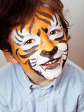 Little cute boy with faceart on birthday party Stock Photo
