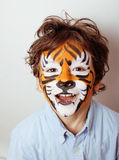 Little cute boy with faceart on birthday party close up, little cute tiger Stock Images