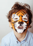Little cute boy with faceart on birthday party close up, little cute tiger Royalty Free Stock Photography