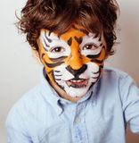 Little cute boy with faceart on birthday party close up, little cute tiger Royalty Free Stock Photos