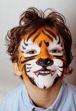 Little cute boy with faceart on birthday party close up, little cute tiger Royalty Free Stock Image