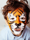 Little cute boy with faceart on birthday party close up, little Royalty Free Stock Photo